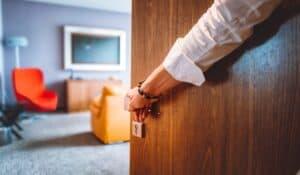 Hotel worker opening room door