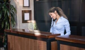 women at hotel receptionist desk on the phone