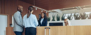 two people checking into a hotel at the front desk