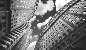 upward shot of tall buildings and the sky