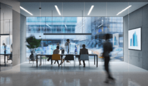 modern office while employees work at table with blurred people walking around