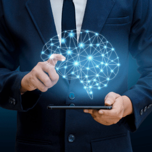 a brain made of white lines and blue glowing circles above a tablet being held by a man in a suit
