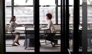 two women in meeting room
