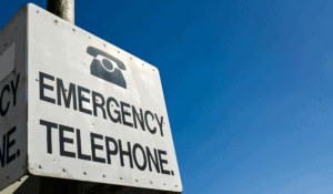 metal sign that has phone icon with text emergency telephone