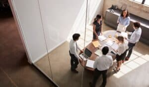 Business group in meeting room all standing up