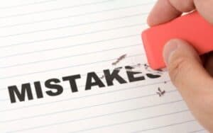 someone using an eraser to erase the word