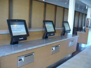 computer monitors in a hotel offering express self check-in and checkout options for guests