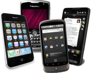photo of four older smart phones opened to messages and home screens